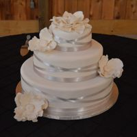 Ribbon Wedding Cake Fondant with silver ribbon and gum paste flowers.