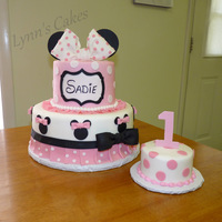 Minnie Mouse Birthday Cake Vanilla cake iced in buttercream with fondant accents.