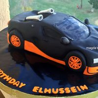 Bugatti Car Cake  carving this cake was really hard , took me a whole day to get it wright , my eyes got crossed moving between the cake and the photos of...