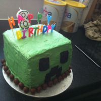 Minecraft Creeper Cake this is a minecraft cake i made. it was a piñata cake inside. it was just buttercream on the outside with fondant face.