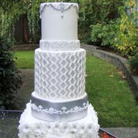 White And Silver Wedding Cake I inspired from the pic that my friend asked me to make and I have mixed with my idea