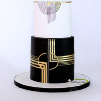 Classic Art Deco Finally got a chance to work on an art Deco cake!! Classic Black and White party theme with hints of gold. So glad the cake was loved by...