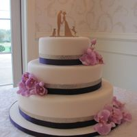 Orchid Wedding Cake fondand covered w/ orchids.