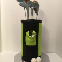 Patrick's Golf Cake I made this for my son's birthday. It was Devils Food cake with chocolate filling. The putter and the irons were made out of gum paste...