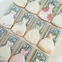 Wedding Dress Cookies Wedding dress decorated cookies. Door and hanger are fondant, dress is royal icing.