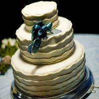 Wedding Cake With Fondant Waves For Beach Wedding  I made may daughter's wedding cake for Sanibel Wedding.I rolled fondant in long rolls and used Clear Vanilla to glue onto...