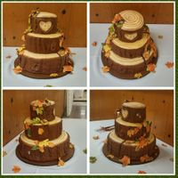 Fall Themed Tree Section And Leaves Wedding  Bride and Groom wanted fall themed wedding cake. Tree sections with fall colored leaves.Cake is white vanilla, covered in BC, and homemade...