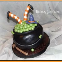 Witches Pot Green vanilla bean cake and black chocolate icing inside. Everything is edible using marshmallow fondant.