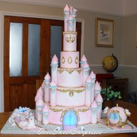 Princess Castle For A 1St Birthday This cake was huge!! The little pond was made from isomalt and lights up. There was also a little swing hanging from one of the trees. The...
