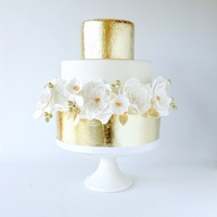 White And Gold Wedding Cake White and gold wedding cake with sugar roses.