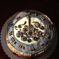 Steampunk Pocketwatch buttercream covered round cake with fondant gears, fob and chain