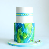 Artist's Corner   Simple but yet elegant cake with a textured blue and green tiled bottom tier.Especially in love with the colours!