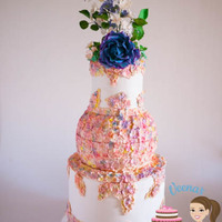 Hydrangea Blooms Wedding Cake A beautiful wedding cake inspired by Hydrangeas.. The top is a Rose with sugar blossoms