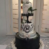 "Black And White Wedding This was design by the bride-when first approached,the cake in the sketch looked like two 4"" cakes and a larger(in diameter) tier on..."