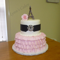 Parisian Love Strawberry cake with buttercream icing and fondant ruffles with brooch and Eiffel Tower figurine.