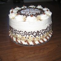 Cannoli Cake 3 layer filled with cannoli cream. each cream layer topped with mini chocolate chips.