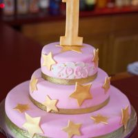 1St Birthday Cake Fondant covered vanilla cake with gold dusted fondant stars and #1 topper