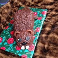 "Beaver Celebrating a dear friends birthday with a beaver. All edible MMF, double chocolate cake, with chocolate buttercream presented on a ""..."