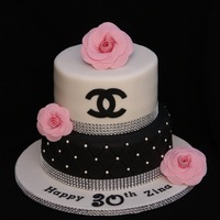 Chanel Bling Cake With Sugar Chanel Camellias  Hand made sugar paste Chanel flowers. The bottom tier is quilted although the lighting in the photo doesn't show it off very well....