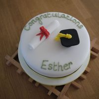 Graduation Cake   Plain sponge filled with vanilla buttercream. For a friend's University graduation - degree colours are a soft green and yellow.
