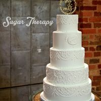 Piped White Wedding Cake Piped white wedding cake 250 servings.