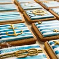 Nautical Biscuits These biscuits are decorated with royal icing, with a white, navy and gold maritime theme. More pictures on my website here: www....