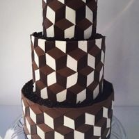 Optical Illusion Saw this on Wicked Goodness. Made a few mistakes but it was a fun cake to try.