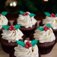 Christmas Cupcake (Chocolate) Chocolate mud cupcakes with salted caramel buttercream. (dusted cocoa powder on top). Holly leaves made of royal icing. Read more at http...