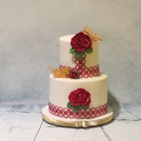 Red Rose This is a cake for wonderful friends Anniversary.Top tier is vanilla bean filled with Pina colada smb. The bottom tier is a strawberry...