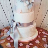 Pure Elegance Hello my everyone, this beautiful romantic wedding cake was created according to the wishes of the bride and I then put their ideas into...