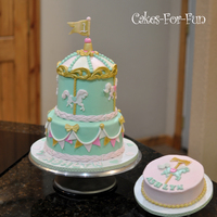 Carousel Birthday Cake Pastel colored tiered carousel cake for baby's first birthday. Coordinated smash cake.