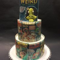 Comic Monster Cake is covered in wafer paper. Green monster is gumpaste.