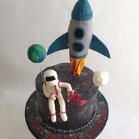 Outer Space Birthday Cake Buttercream WASC cake with fondant decorations.