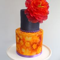 Bold Autumn My daughter's surprise birthday cake. I mixed a custom lustre to paint the top tier and since I always seem to run out of time...