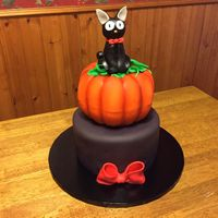 Kiki's Delivery Service Halloween Cake I made this cake for my daughter's 18th birthday/Halloween party. Bottom tier is chocolate cake with chocolate buttercream frosting....