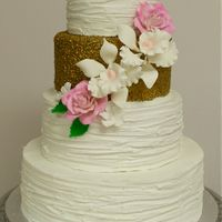 Textured Buttercream & Gold Wedding Cake 4 tier wedding cake with white textured buttercream. One tier with fondant sequins. Sugar flowers.
