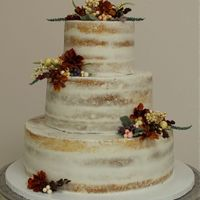 Semi Naked Wedding Cake   3 tier Semi Naked Wedding Cake. Decorated with berries & flowers.
