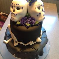 Halloween Wedding I decorated this for my own wedding. The base cake is actually a dummy, as we were having a ton of desserts. The small layer and the skulls...