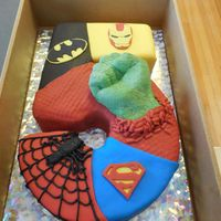 Super Hero Cake To make the hulk fist, I used my son's hand and cast it into brown sugar. I then melted green candy melts and poured them in. After...