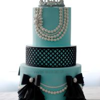 Breakfast At Tiffany's Birthday Cake Cake made for my niece's first birthday. The theme was base on the classic movie Breakfast at Tiffany's. Wafer paper ruffles and...