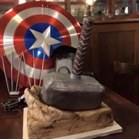 Thor's Hammer Made for a friend who's big into cosplay, and Thor is his main character. Cake base and hammer are chocolate cake with raspberry...