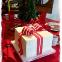 Christmas Present Cake I actually did this last year for my neighbor. It was a last minute request so I was looking for something fairly simple. Found it on the...