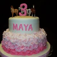 "Horsies And Pink Ruffles My 3 year old niece said she wanted her birthday cake to have ""horsies and pink ruffles."" That's what she got."