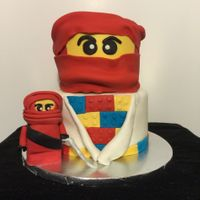 Lego Kai Ninjago I made this for my Grandson's birthday. It was a vanilla cake with strawberry filling and a chocolate cake with vanilla buttercream....