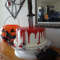 Bloody Cake 8 inch frosted in buttercream, red ganache and the knife is plastic.