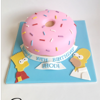 Simpsons Birthday Cake Happy 10th Birthday Brodi! Bart and Homer and handmade and edible and the donut is hand carved from yummy white vanilla cake. The sprinkles...