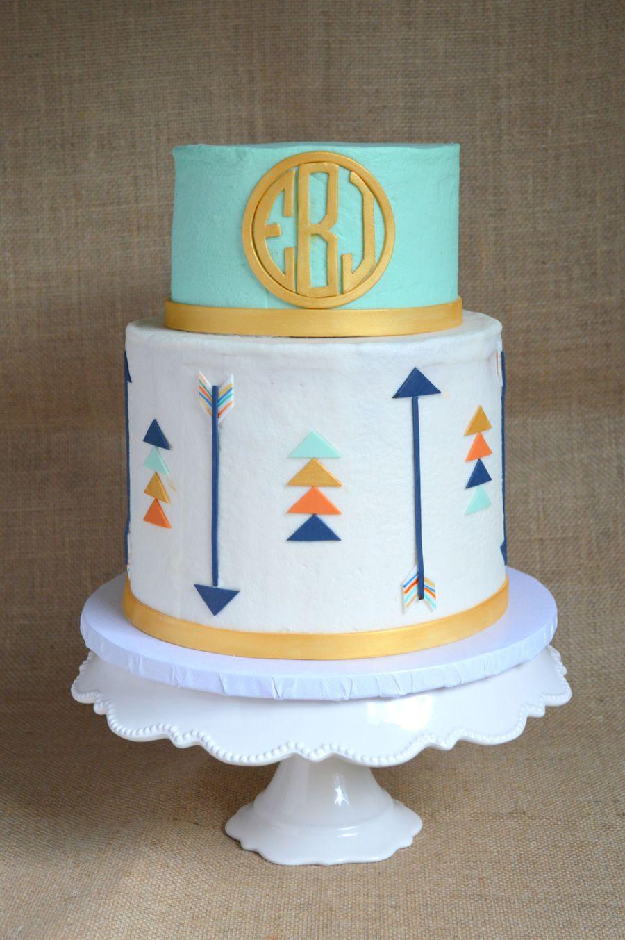 mint and gold circle monogram arrow cake