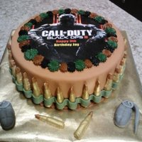 Black Op Iii Fondant Cake With Ammo MADE BULLET MOLD WITH HOT GLUE GUN. AIRBRUSHED BULLETS AND HAND PAINTED BULLET TIPS. BLACK OPS IMAGE IS LAMINATED WITH GLAD PRESS-N-SEAL ON...