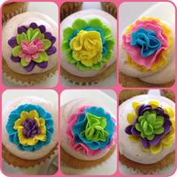Mexican Paper Flowers Inspired Cupcakes  We had a bake-off for a charity fundraiser at the office. This was my entry... banana cupcakes with dulce de leche filling and cinnamon...