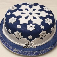 Snowflake Christmas Cake Rich fruit cake covered in fondant. All accents are made from gumpaste